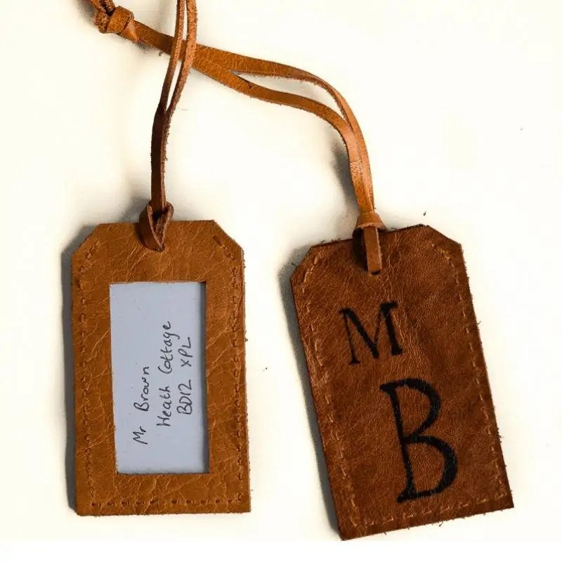 DIY Gifts For Long-Distance Boyfriend: Leather Luggage Tags via Vicky Myers Creations