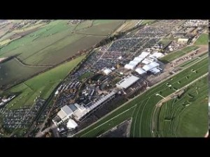James Kenwright flying a helicopter over Cheltenham Racecourse during the November 2017 meeting.