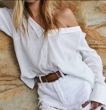 A white button shirt made off-shoulder: