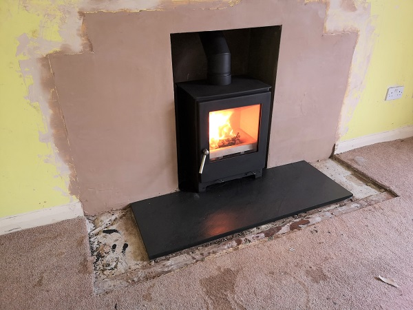 Fireplace enlargement and stove installation near Yeovil, Somerset.