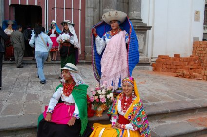 Local women in bright colored clothing in Ecuador.