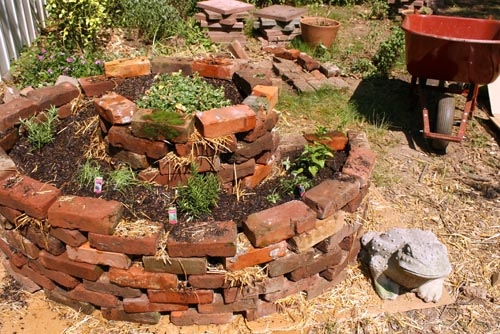 Our pair of herb spirals are my favorite part of our new backyard garden. Here's how to build an herb spiral of your very own!