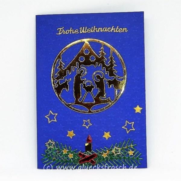 blaue Weihnachtskarte mit Krippe