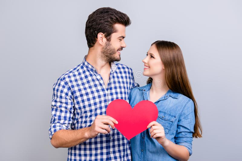 love-story-trust-feelings-emotions-joy-happy-young-lovely-couple-posing-wearing-casual-shirts-holding-big-red-paper-118470253
