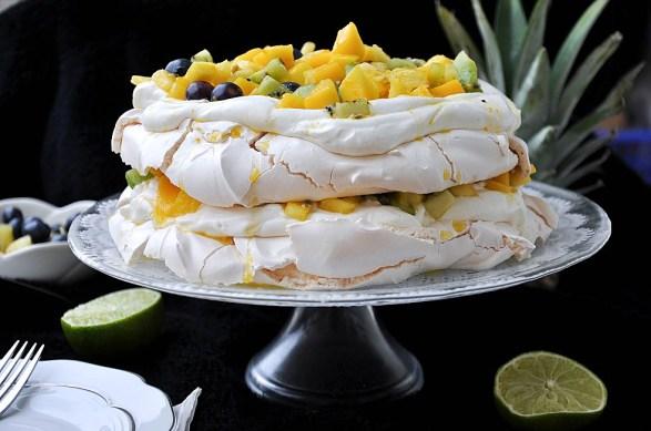 Mango & Pineapple Pavlova by Pretty Sweet Blog. Luscious layers of gluten free heaven.