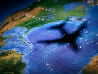 Airplane Flying Over the Globe