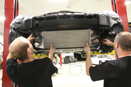 After installing the air shroud , the intercooler can now be bolted in place. ProCharger offers a vertical or horizontal mounting position for the intercooler. The vertical style kit is used in this installation.