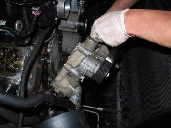 Next up the water pump comes off. If your pump has a lot of miles on it, now is the time to consider replacing it with a fresh one.