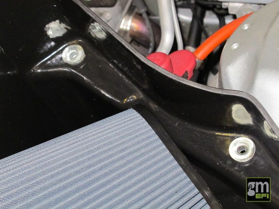 This is where you reuse the rubber mounting grommets saved from the factory airbox.