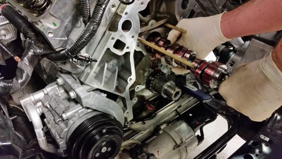 With the timing chain removed, the Stage II bumpstick gets slid into place, complete with properly-applied camshaft lube.