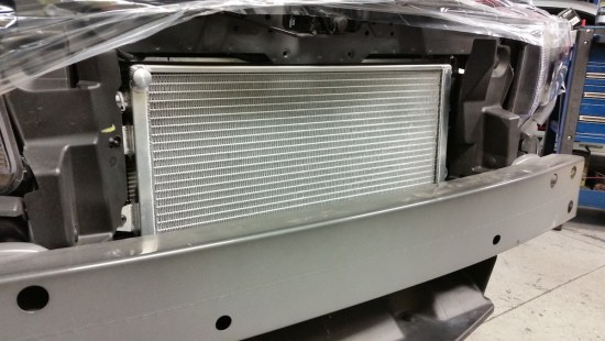 ...Ron Davis high-capicity heat exchanger. With over 850 crank horsepower being generated from this package, the OEM heat exchanger just won't cut it!