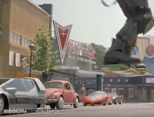 Eagle-eyed viewers of BTTF2 would have clearly noticed the Poncho dealership in the background in one of the earlier scenes of the film. As a kid, I always wondered what the Pontiac brand would have looked like because of this.