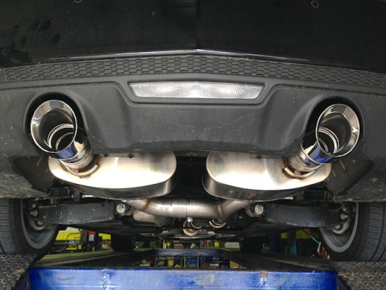 The look of the rear of the car was improved 100%, by eliminating that large, bulky muffler hanging down. These mufflers are also a bit lighter than factory single unit as well.