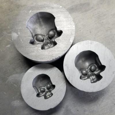 3 skull molds in graphite
