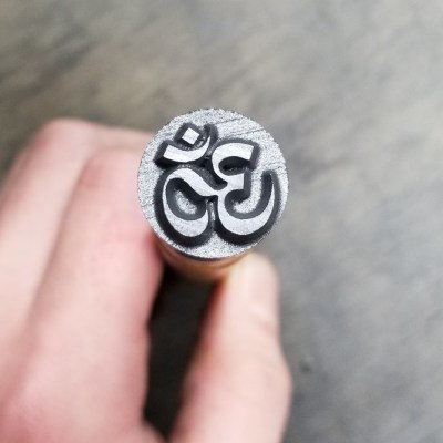 This Graphite Stamp Features an Ohm Symbol Stamp