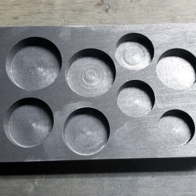 A preform graphite gauge mold.