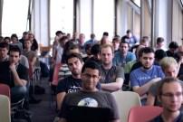 Attendees listen to a talk. (Photo by Jakub Steiner.)
