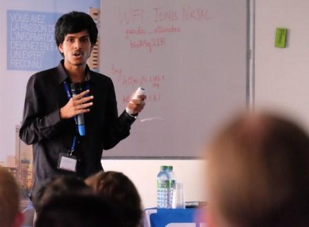 Sai Suman Prayaga gives his lightning talk. (Photo by Garrett LeSage.)