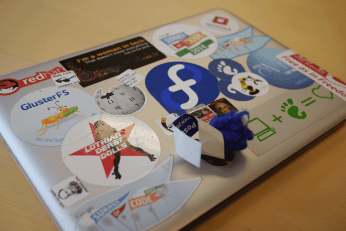 Laptop with Free Software stickers at GUADEC BoF (Photo by Oliver Propst.)