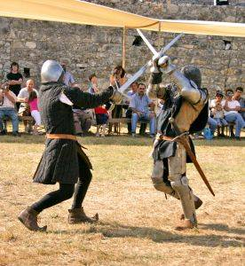 Knights engaged in a sword fight