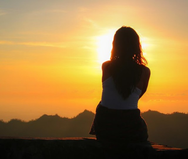 A Woman Watching The Sunset