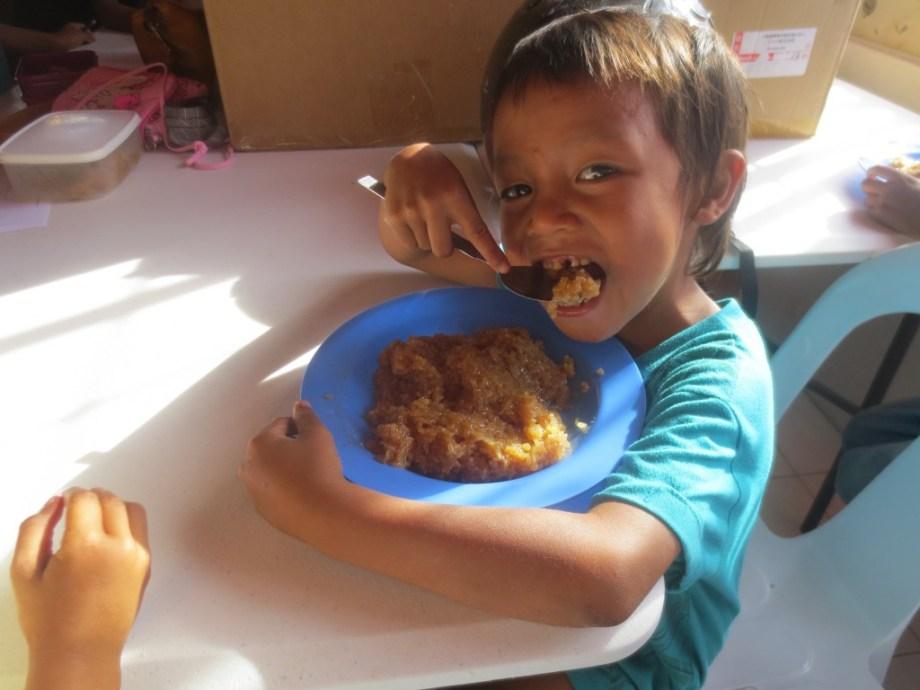 Jon-Jon enjoying sticky rice