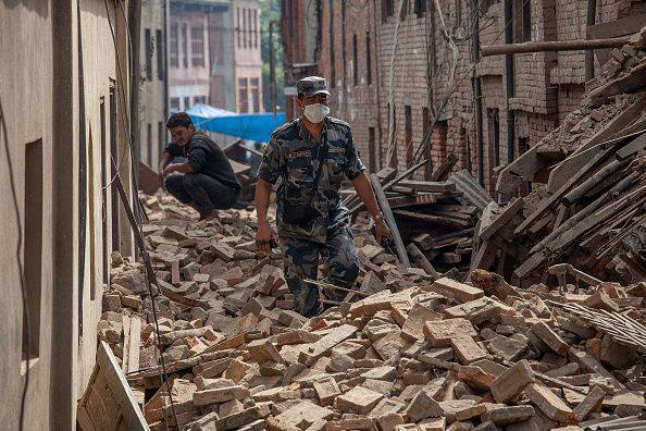 Soldier wading through debris in Nepal