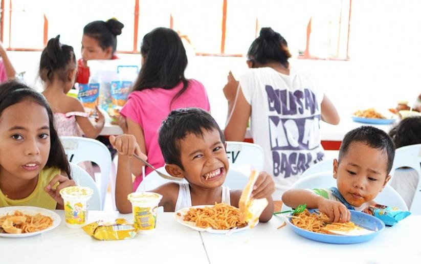 Kids eating during their feeding program