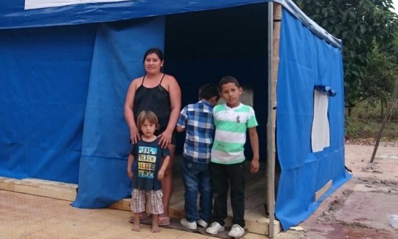 Earthquake survivors near their temporary home in Ecuador