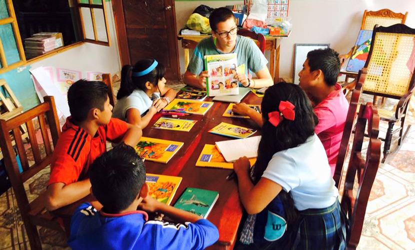 a Peace Corps volunteer, teaching a lesson at Hope