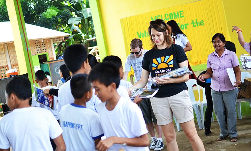 Elsa Thomasma and Tom Gore distributing school materials