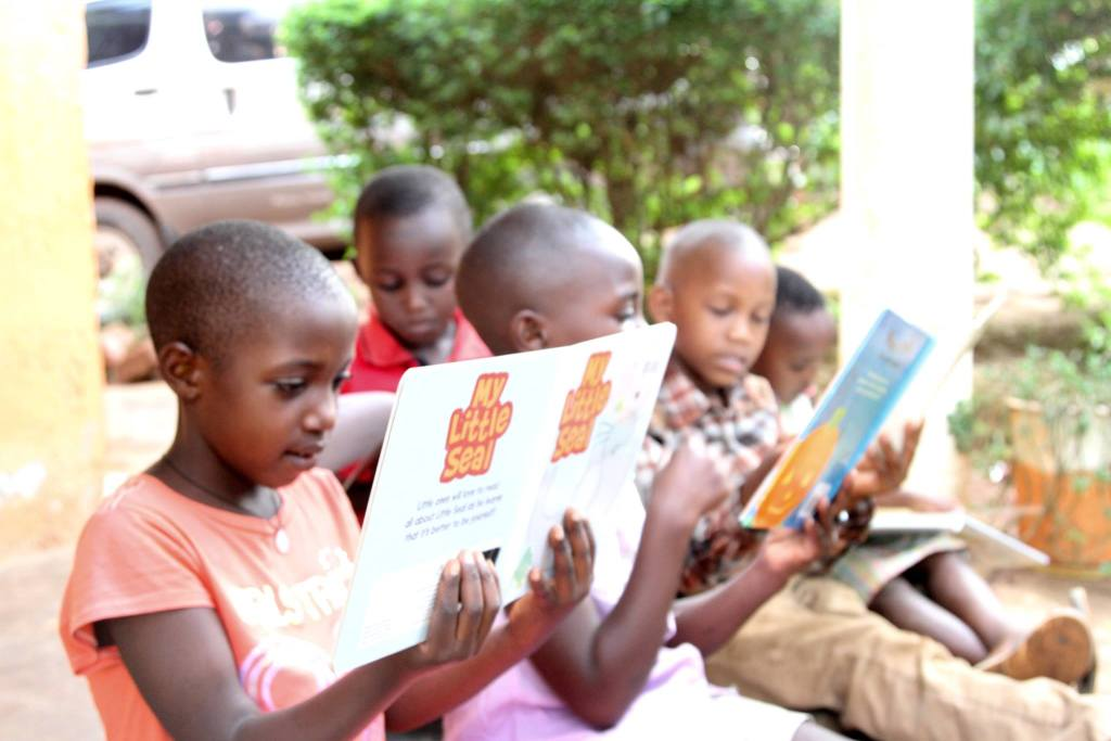Kids in Uganda reading Pangea Publishing books