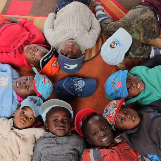 Swazi children laying on the floor in a circle
