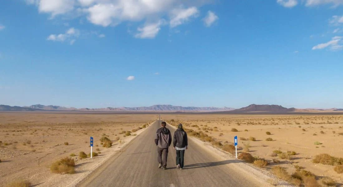 how to make money from home. Our story. Walking down road in Iran
