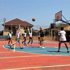 Group playing basketball