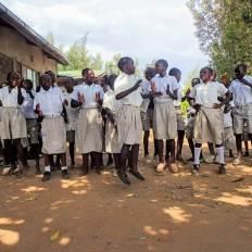 Students in Kenya singing and dancing