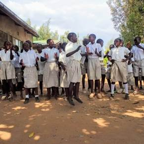 Students in Kenya singing and dancing