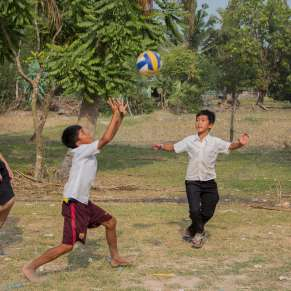 Boys playing volleyball in Cambodia