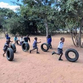 Kids rolling tires