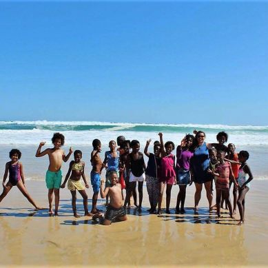 Group of children posing for a photo on the beach