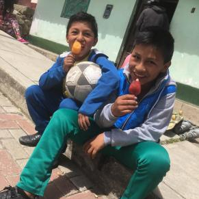 Kids cooling off with a Popsicle after playing fútbol!