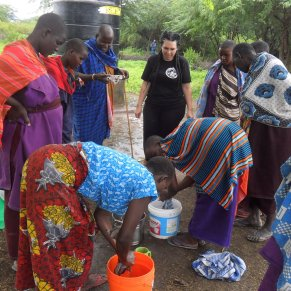 Volunteer making soap with locals in Tanzania