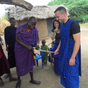 Volunteer laughing with locals in Tanzania