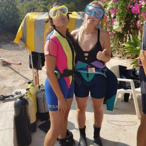 Volunteers preparing to go SCUBA diving in Spain