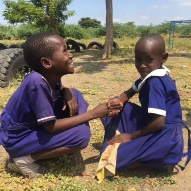 Two young Tanzanian children holding hands