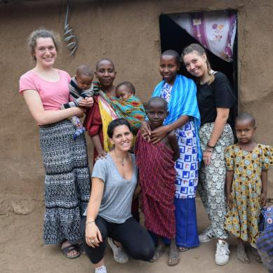 Volunteers with a local Tanzanian family
