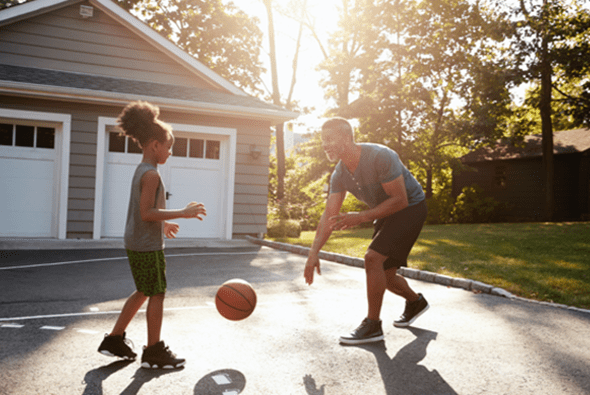 Father and Child Playing Basketball in Driveway