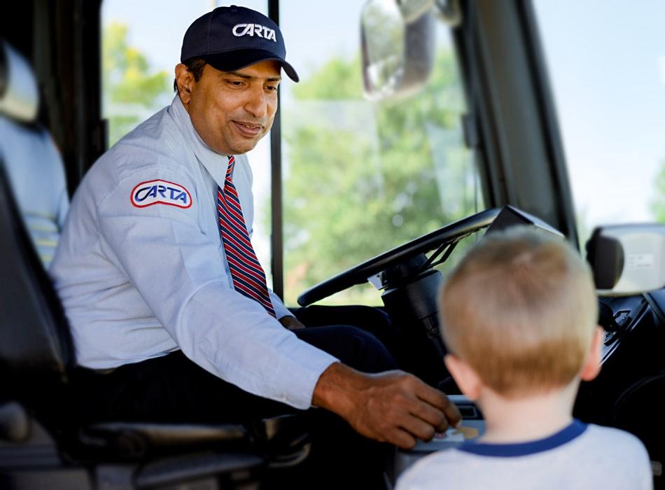 CARTA bus driver helps a little boy.