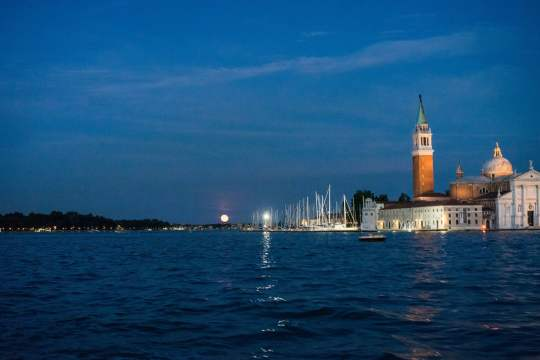 Strawberry Moon as seen from a Vaporetto (Water Bus), Venice, Italy