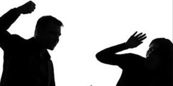 Husband beating wife